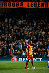 """Galatasaray Forward Didier Drogba (CIV) walks off for half time in front of a """"Drogba Legend"""" banner hungs by Chelsea supporters - Photo mandatory by-line: Rogan Thomson/JMP - 18/03/2014 - SPORT - FOOTBALL - Stamford Bridge, London - Chelsea v Galatasaray - UEFA Champions League Round of 16 Second leg."""