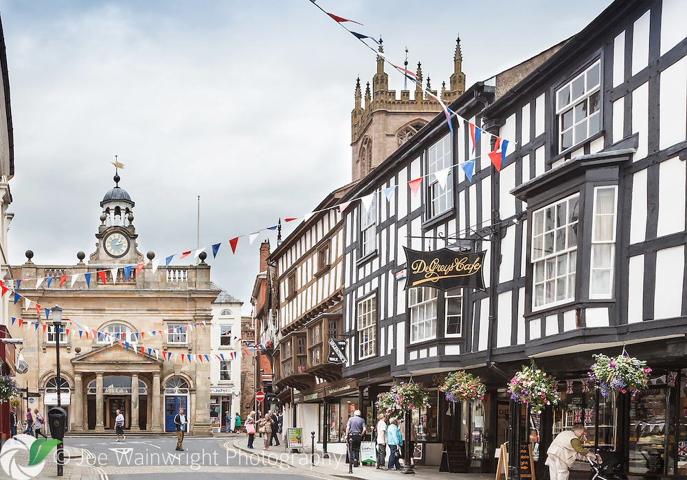 The view up Broad Street, Ludlow, towards the Buttercross.  De Grey's cafe, pictured, dates back to 1570.