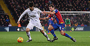 James McCarthur jockies Ki Sung Yeung during the Barclays Premier League match between Crystal Palace and Swansea City at Selhurst Park, London, England on 28 December 2015. Photo by Michael Hulf.