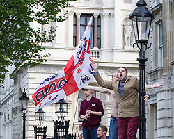 © Licensed to London News Pictures . 27/05/2013 . London , UK . After the demonstration has ended , approximately 100 EDL supporters charge down Whitehall to Downing Street where police contain them by the gates . The EDL march along Whitehall and hold a demonstration opposite Downing Street today (Monday 27th May 2013) . Photo credit : Joel Goodman/LNP