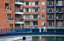 IRELAND DUBLIN MAR00 - A pedestrian crosses a bridge in Dublin's Docklands, a recent development inclusing modern housing and office space... jre/Photo by Jiri Rezac. . © Jiri Rezac 2000. . Tel:   +44 (0) 7050 110 417. Email: info@jirirezac.com. Web:   www.jirirezac.com