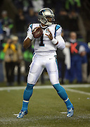 Carolina Panthers quarterback Cam Newton (1) drops back to pass during the NFL week 19 NFC Divisional Playoff football game against the Seattle Seahawks on Saturday, Jan. 10, 2015 in Seattle. The Seahawks won the game 31-17. ©Paul Anthony Spinelli