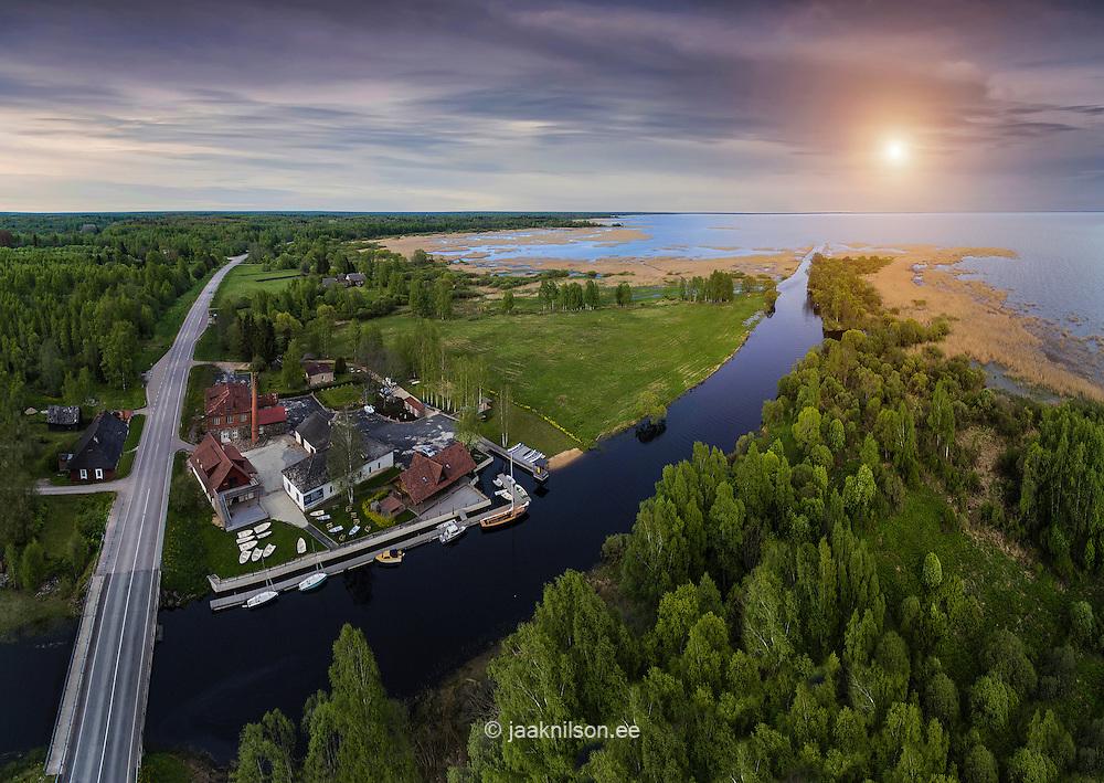 Small roadside Oiu marina by river Tänassilma mouth. Lake Võrtsjärv, Estonia. Road, highway.