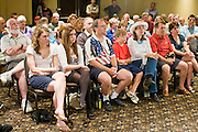 "July 10, 2010 - PHOENIX, AZ: People listen to US Sen John McCain (R-AZ) during a town hall meeting in Phoenix. Sen. McCain held a ""town hall"" meeting at a hotel in Phoenix Saturday morning. He criticized the Obama administration's handling of the war in Afghanistan, specifically the July 2011 date for the beginning of the withdrawl of US forces, the administration's handling of the immigration and border security issue and the recently passed health care reform bill, which he called ""Obamacare."" McCain is in a primary battle with former Congressman JD Hayworth, he did not mention Hayworth, by name during the meeting.   Photo by Jack Kurtz / ZUMA Press"