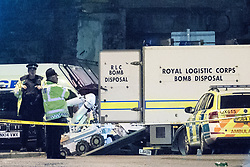© Licensed to London News Pictures. 23/05/2017. Manchester, UK. The Royal Logistic Corps Bomb Disposal team deploy a bomb disposal robot outside the Manchester Arena . Police and other emergency services are seen near the Manchester Arena after reports of an explosion. Police have confirmed they are responding to an incident during an Ariana Grande concert at the venue. Photo credit: Joel Goodman/LNP