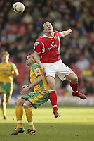 Photo: Aidan Ellis.<br /> Barnsley v Norwich City. Coca Cola Championship. 03/03/2007.<br /> Norwich's Darren Huckerby (L) loses out to Barnsley's Bobby Hassell