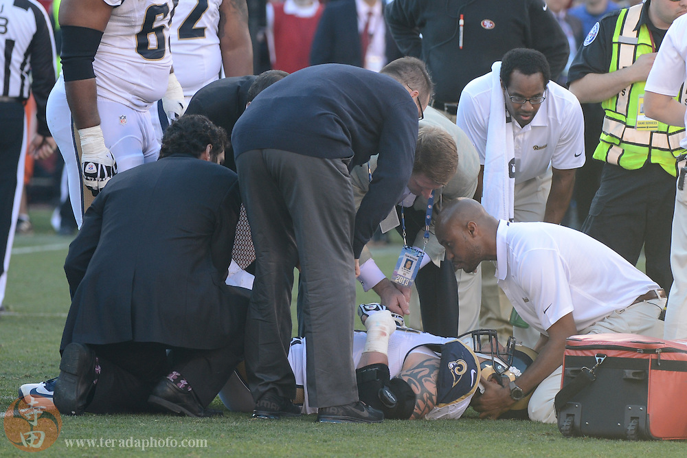 December 1, 2013; San Francisco, CA, USA; St. Louis Rams tackle Jake Long (77) is looked at by medical staff after an injury against the San Francisco 49ers during the third quarter at Candlestick Park. The 49ers defeated the Rams 23-13.