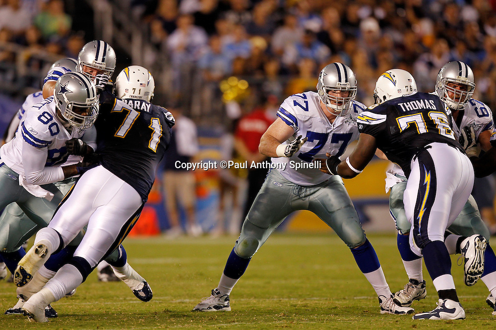 Dallas Cowboys offensive tackle Pat McQuistan (77) blocks during a NFL week 2 preseason football game against the San Diego Chargers on Saturday, August 21, 2010 in San Diego, California. The Cowboys won the game 16-14. (©Paul Anthony Spinelli)