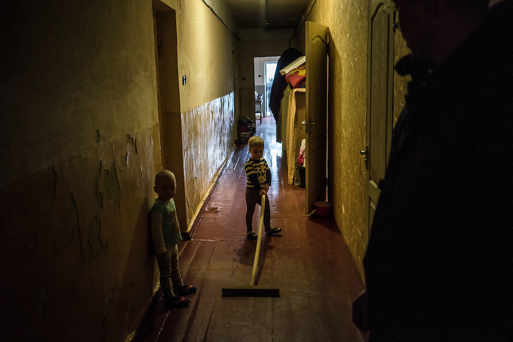 Children play in one of the dormitory-like residence halls at Romashka, a summer camp where several hundred people live after being displaced by fighting in Eastern Ukraine on Friday, February 13, 2015 in Kharkiv, Ukraine.