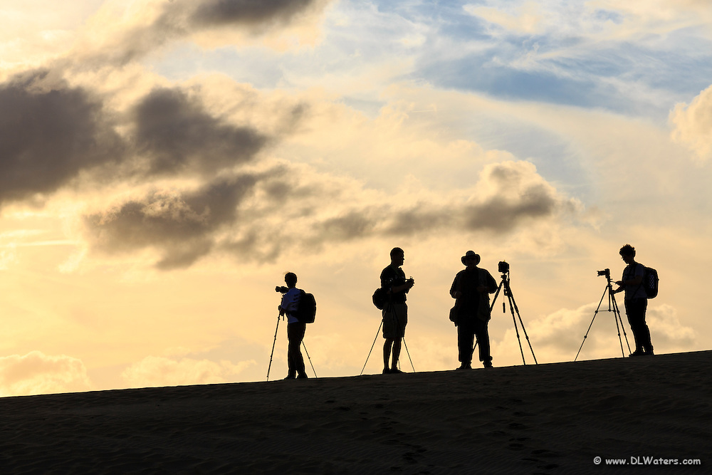 Silhouette of photographers at a Sunset Photo Workshop Dan Beauvais and I taught at jockeys Ridge State Park.