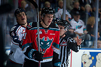 KELOWNA, CANADA - OCTOBER 27: Mitchell Brown #5 of the Tri-City Americans trash talks Kyle Pow #21 of the Kelowna Rockets after a check in to the boards during first period on October 27, 2017 at Prospera Place in Kelowna, British Columbia, Canada.  (Photo by Marissa Baecker/Shoot the Breeze)  *** Local Caption ***