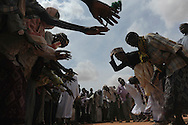 Somali refugees perform the Dikri during celebrations of the Eid ul Fitr to mark the end of Ramadan in the Ifo marketplace at Kenya's Dadaab Refugee Camp, situated northeast of the capital Nairobi near the Somali border, August 2011.