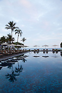 The Four Seasons Resort Hualalai at Historic Kaupulehu on the Big Island of Hawaii. The Beach Tree Pool at sunrise.