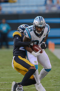 Pittsburgh Steelers quarterback Mason Rudolph (2) tackles Carolina Panthers running back Cameron Artis-Payne (34)during a NFL football game, Thursday, Aug. 29, 2019, in Charlotte, N.C. The Panthers defeated the Steelers 25-19.  (Brian Villanueva/Image of Sport)