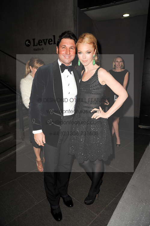 GEORGIO VERONI and his wife TAMARA BECKWITH at The Love Ball hosted by Natalia Vodianova and Lucy Yeomans to raise funds for The Naked Heart Foundation held at The Round House, Chalk Farm, London on 23rd February 2010.