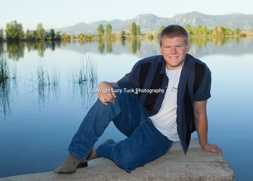 High School Senior Picture by lake overlooking mountains.  Full body high school senior picture