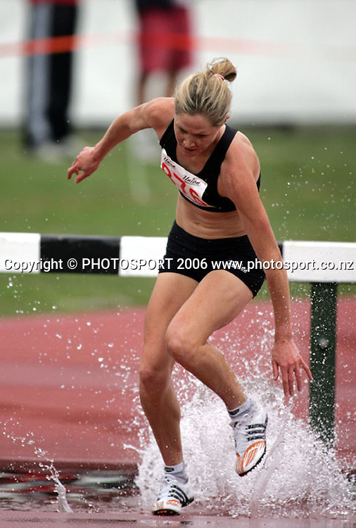 Kate McIlroy (Wellington) nearly takes a tumble while competing in the Womens 3000m steeplechase during the Athletics New Zealand Track and Field Championships at QEII Park, Christchurch on Saturday 28 January 2006. Kate went on to win the event. Photo: Tim Hales/PHOTOSPORT