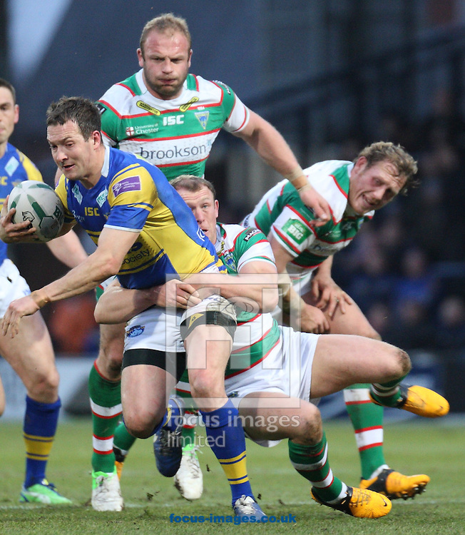 Picture by Stephen Gaunt/Focus Images Ltd +447904 833202.07/04/2013.Danny McGuire(left) of Leeds Rhinos  Ben Westwood(Right)  misses the tackle for Warrington Wolves during the Super League match at Headingley Carnegie Stadium, Leeds.