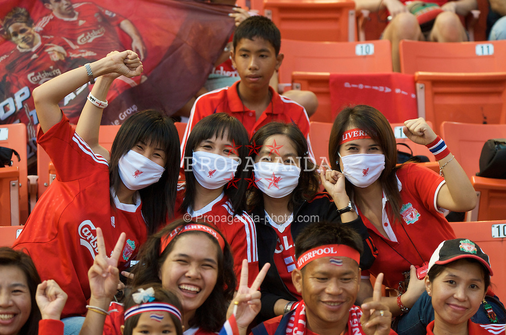 BANGKOK, THAILAND - Wednesday, July 22, 2009: Thai Liverpool supporters wearing swine flu masks before the preseason friendly match against Thailand at the Rajamangala Stadium. (Pic by David Rawcliffe/Propaganda)