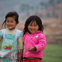 Two children in Sopsokha Village in front of the wheat fields, Punakha District, Bhutan