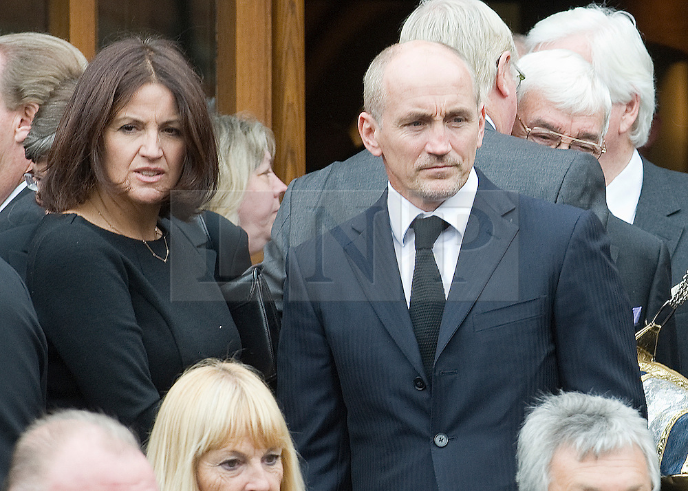 © licensed to London News Pictures. 18/05/2011. Tonbridge, UK. Barry McGuigan and his wife Sandra at the funeral of heavyweight boxing legend Sir Henry Cooper at Corpus Christi Church in Lyons Crescent, Tonbridge, Kent today (18/05/2011).  Please see special instructions for usage rates. Photo credit should read Ben Cawthra/LNP