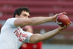Nov 12, 2011; Stanford CA, USA;  Stanford Cardinal quarterback Andrew Luck (12) warms up before the game against the Oregon Ducks at Stanford Stadium.  Mandatory Credit: Jason O. Watson-US PRESSWIRE