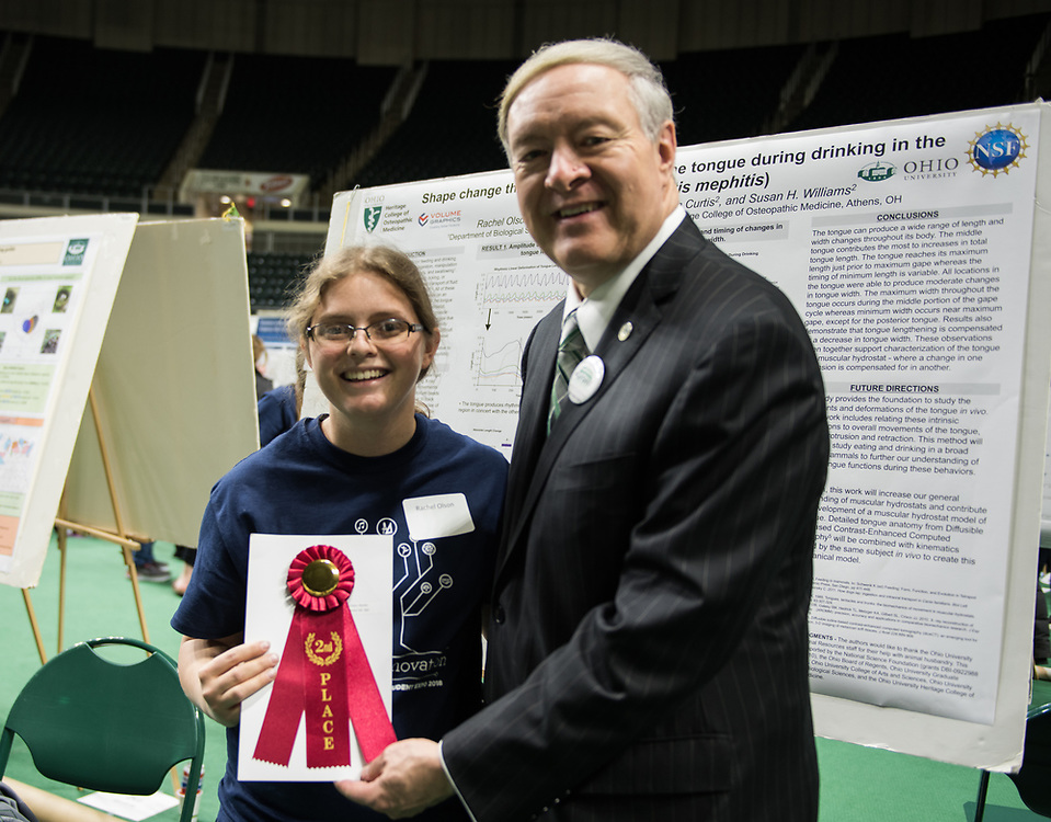Rachel Olson poses for a picture with Ohio University President Duane Nellis during the 2018 Student Research Expo.