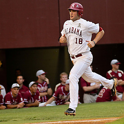 June 04, 2011; Tallahassee, FL, USA; Alabama Crimson Tide first baseman Austen Smith (18) scores during the first inning of the Tallahassee regional of the 2011 NCAA baseball tournament against the Florida State Seminoles at Dick Howser Stadium. Mandatory Credit: Derick E. Hingle