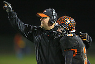 Springville head coach Joe Martin talks with quarterback Sam Sciver (3) during their game at Allison Field in Springville on Friday October 19, 2012. Midland defeated Springville 30-29.
