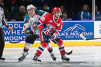 KELOWNA, CANADA - MARCH 7: Tyson Baillie #24 of Kelowna Rockets checks Calder Brooks #20 of Spokane Chiefs on March 7, 2015 at Prospera Place in Kelowna, British Columbia, Canada.  (Photo by Marissa Baecker/Shoot the Breeze)  *** Local Caption *** Tyson Baillie; Calder Brooks;