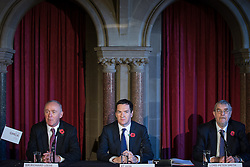 © Licensed to London News Pictures . Manchester , UK . FILE PICTURE DATED 03/11/2014 of Sir Richard Leese , The Chancellor of the Exchequer , George Osborne MP and Lord Peter Smith at Manchester Town Hall signing a deal to devolve power to Greater Manchester , including giving the city a Mayor and greater control over its finances . Today (24th February 2015) it has been revealed that , as part of the devolution deal , Greater Manchester will gain control of its entire £6 billion NHS budget - 25% of the government's spending in the region , and all administrative control too . Photo credit : Joel Goodman/LNP