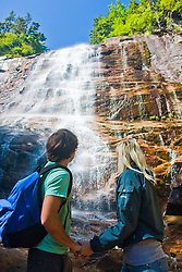 A couple hiking at Arethusa Falls in Crawford Notch State Park in New Hampshire's White Mountains.