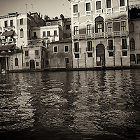 View across the canal in Venice to old buildings with reflections