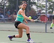 Iowa City West's Addy Riley eyes the ball for a return during the Class 2A state team tennis tournament at Veterans Memorial Tennis Center in Cedar Rapids on Saturday, June 1, 2013.