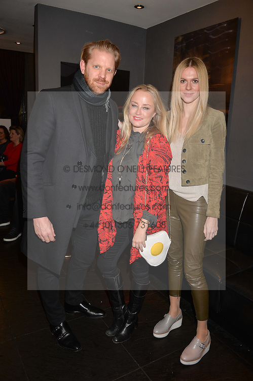 Alistair Guy, Erica Bergsmeds and Barbora Bediova at an exhibition of photographs by Erica Bergsmeds held at The Den, 100 Wardour Street, London England. 19 January 2017.