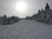 Skiing Upper East Fall trail early November at Killington, VT