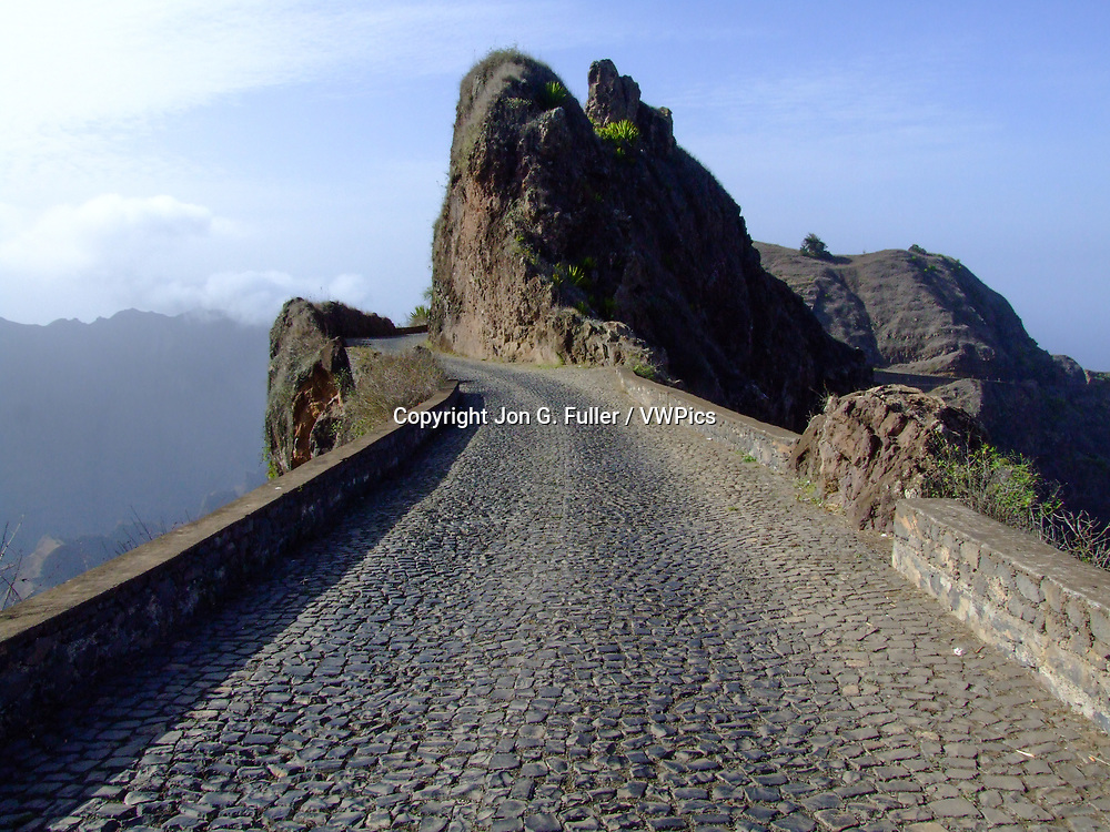 The  Rua de Corda was first built by slaves on the narrow crest of the Delgadinho mountain ridge  in the mountains of Santo Antao, Republic of Cabo Verde.  This road crosses the island from Porto Novo on the south to Ribeira Grande on the north.
