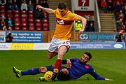 Jake Mulraney of Hearts goes to ground to win the ball from Jake Hastie of Motherwell during the Ladbrokes Scottish Premiership match between Motherwell and Heart of Midlothian at Fir Park, Motherwell, Scotland on 17 February 2019.