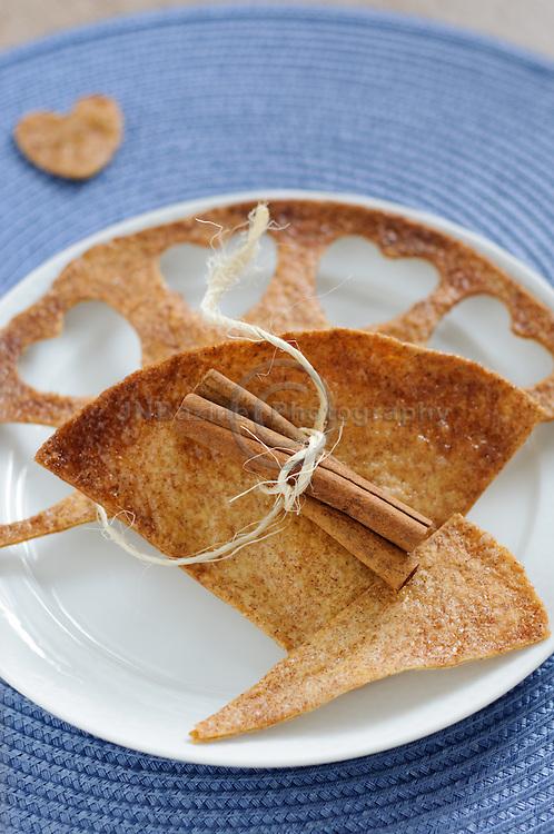 Cinnamon tortilla crisp wedges with heart shape cutouts.
