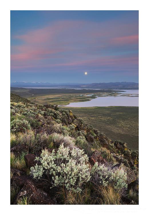 Full moon setting over Warner Lakes Wetlands, seen from Hart Mountain National Antelope Refuge, Oregon