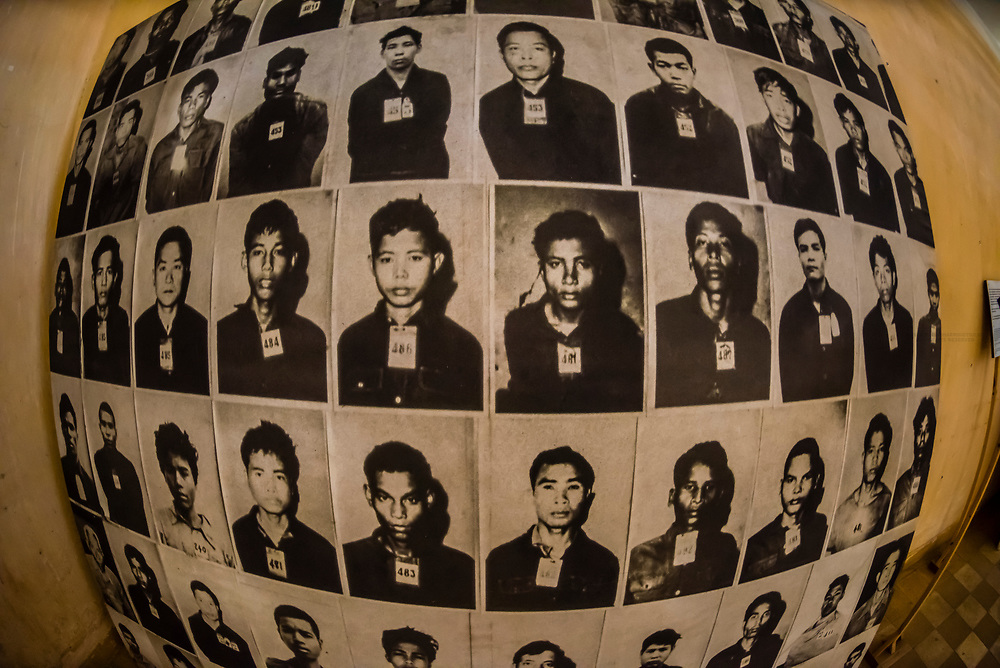Portraits of prisoners, victims of Khmer Rouge genocide, Tuol Seng Genocide Museum; originally a school, it was turned into the Khmer Rouge Torture headquarters. Men, women and children were tortured and killed before being moved under darkness to be buried in mass graves at the Killing Fileds of Choeung Ek (outside the city); Phnom Penh, Cambodia.