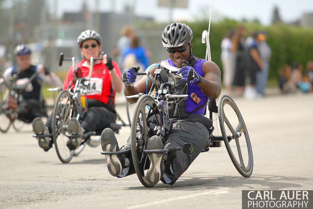 July 4th, 2006:  Anchorage, Alaska - James McGilberry (554), Army veteran from Banning, Calif, heads down the main straight in the 5k handcycle event at the 26th National Veterans Wheelchair Games.