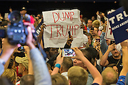 """Black Lives Matter protestors clash with Trump supporters at Republican presidential candidate Donald Trump's campaign rally in New Orleans, as they are escorted out by security. <br /> The New Orleans rally on Friday, March 4, 2016 at Lakefront Airport took place a day before the primary vote.  Trump was disappointed with security at the event, <br /> """"I can't believe that in Louisiana it takes this long. That's not good for your reputation, I have to tell you. ... Louisiana, that's not like you. That's not your reputation,"""""""