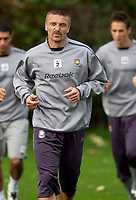 Photo: Daniel Hambury.<br />West Ham Utd Training. 03/11/2005.<br />Tomas Repka grimaces during training.