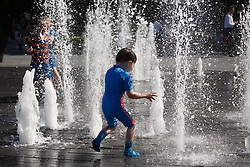 Image ©Licensed to i-Images Picture Agency. 04/07/2014. London, United Kingdom. Hot weather with 27ºC in the capital. Children play with water in a hot and sunny day in Central London. Picture by Daniel Leal-Olivas / i-Images