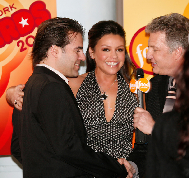 Rachael Ray (center) and her husband (left), is interviewed by Marc Summers (right) before the First Food Network Awards Show held at the Jackie Gleason Theater of the Performing Arts, in Miami, FL on  Feb 23, 2007.  (Photo/Lance Cheung) <br /> <br /> PHOTO COPYRIGHT 2007 LANCE CHEUNG<br /> This photograph is NOT within the public domain.<br /> This photograph is not to be downloaded, stored, manipulated, printed or distributed with out the written permission from the photographer. <br /> This photograph is protected under domestic and international laws.