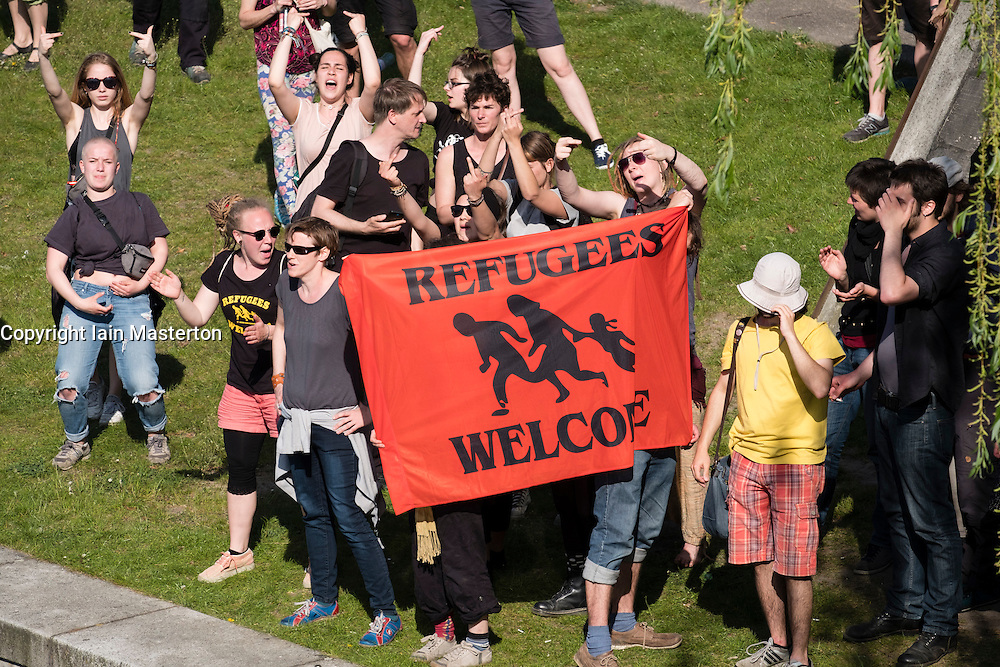 Berlin, Germany. 7th May 2016. Pro-refugee protestors stage counter demonstration against  far -right demonstrators in Berlin Germany. Far-right protesters were demonstrating against islam, refugees and Angela Merkel in Mitte Berlin. Protestors demanded that Chancellor Angela Merkel stand down because of allowing large numbers of refugees and migrants to enter Germany.