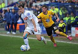 Tranmere Rovers's Liam Ridehalgh competes with Wimbledon's Tom Beere - Photo mandatory by-line: Richard Martin-Roberts/JMP - Mobile: 07966 386802 - 28/03/2014 - SPORT - Football - Birkenhead - Prenton Park - Tranmere Rovers v AFC Wimbledon - Sky Bet League Two