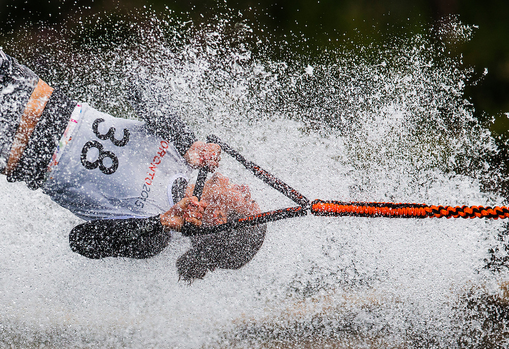 Adam Pickos of the USA competes during the men's waterski tricks preliminary round at the Pan Am Games in Toronto, Monday July 20, 2015.    THE CANADIAN PRESS/Mark Blinch