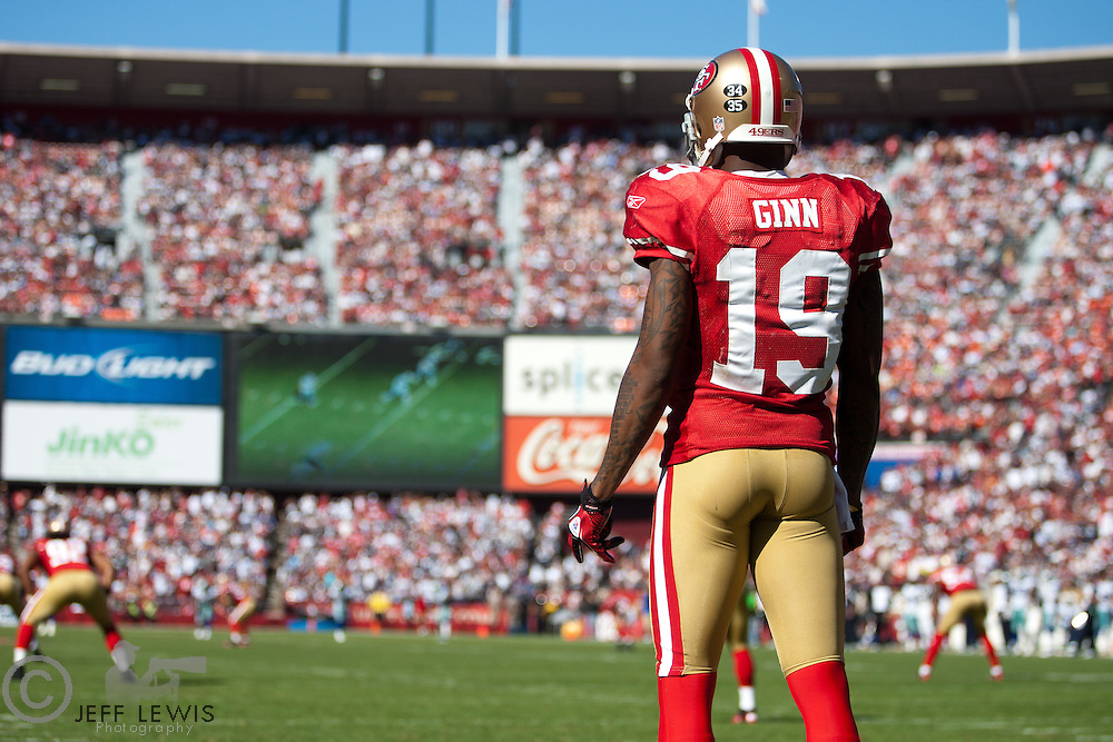 18 September 2011: Kickoff returner (19) Ted Ginn, Jr. of the San Francisco 49ers waits for a kickoff against the Dallas Cowboys during the second half of the Cowboys 27-24 overtime victory against the 49ers in an NFL football game at Candlestick Park in San Francisco, CA